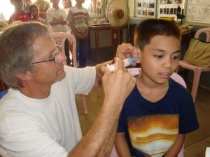 Dr. Woodruff takes a child's ear impression