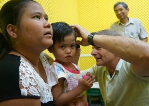 Child gets her ears examined by Dr. Woodruff