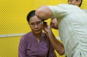 Burmese lady has her ears examined