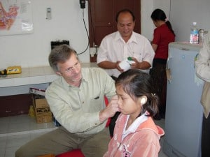 Taking ear impressions of a Laos student
