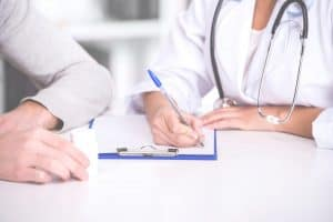 Doctor And Patient Look Over A Form