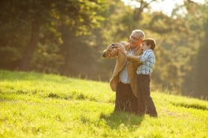 Grandpa With Grandson in Field