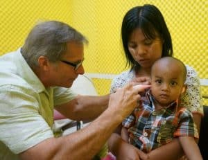 doctor examines a boy's ear
