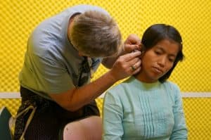Woman Getting Fitted For a Hearing Aid