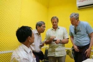 Group of Men Discuss