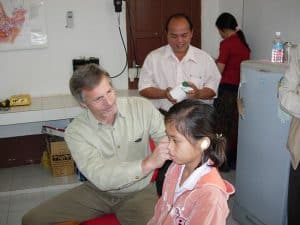 child at ear exam with doctor