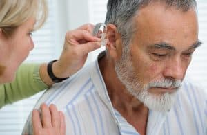 Older Man Hearing Aid Fitting