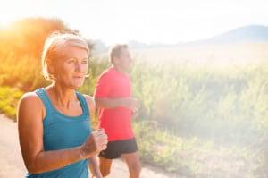 woman and man jog together