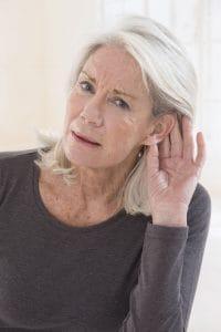 elderly woman trying to listen
