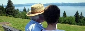 Couple Sits on Bench Looking at Scenery