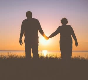 Silhouetted Couple Holds Hands