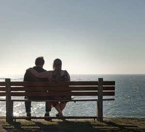 Couple Seated On A Bench