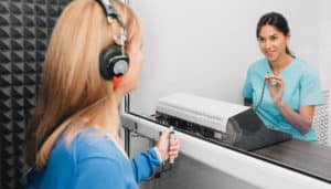 Audiologist Doing A Hearing Test