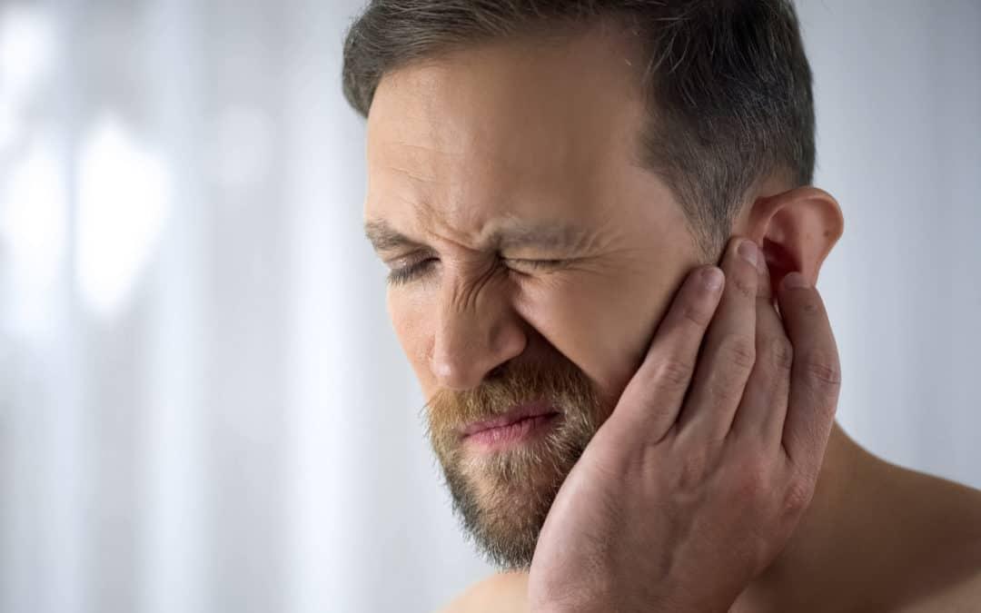 Man holding his aching ear